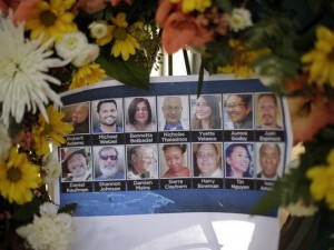 Pictures of San Bernardino shooting victims are displayed at a makeshift memorial.